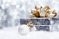 Christmas gift in falling snow Stock Photo