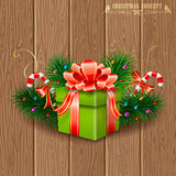 Christmas Gift. With Fir Branches, Candy and Streamer on Wooden Boards background, vector illustration Stock Images