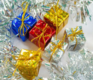 Christmas gift in foliage wrapping with festive decor. Royalty Free Stock Photo