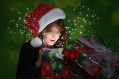 Christmas Gift Full of Suprise. Child Looking Into a Christmas Gift Full of Suprise Royalty Free Stock Images