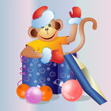 Christmas gift with a fun monkey. Royalty Free Stock Photography