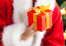 Christmas gift. Girl giving Royalty Free Stock Images