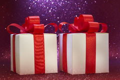 Christmas gift, glitter background. Gift red bow, glitter background Royalty Free Stock Photos