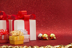 Christmas gift, glitter background. Gift red bow, glitter background Royalty Free Stock Photography