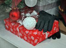 Christmas gift with gloves Stock Photo