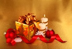 Christmas gift in gold box with bow Stock Images