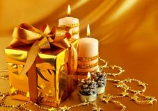Christmas gift in gold box with bow Royalty Free Stock Image
