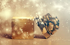 Christmas gift on golden background Stock Photography