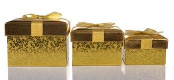 Christmas gift golden boxes Stock Photos