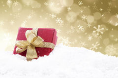 Christmas gift with golden defocused lights. A red christmas gift with golden defocused lights background Royalty Free Stock Photo