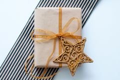 Christmas gift with a golden star Stock Images