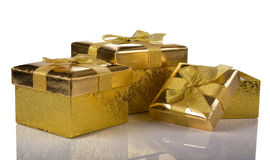 Christmas gift golden three boxes Stock Photo