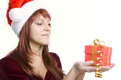 Christmas gift in hands of the woman Stock Images