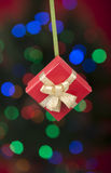 Christmas gift hanging with defocused light Stock Images