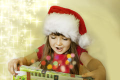 Christmas gift and happy child. Christmas gift  and happy child with stars Stock Photo