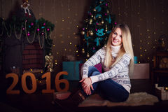 Christmas Gift. Happy surprised beautiful blonde woman opening g Royalty Free Stock Photo