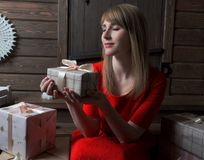 Christmas Gift. Happy woman waiting for the opening of Christmas gifts. Royalty Free Stock Photos