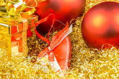 Christmas gift, heart and balls on gloden background Stock Images