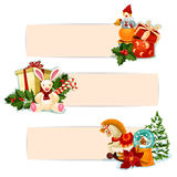 Christmas gift, holly and toy banner set design. Christmas gift banner set. Present boxes with bow, holly berry, candy cane, xmas tree, snow globe, poinsettia Stock Photo