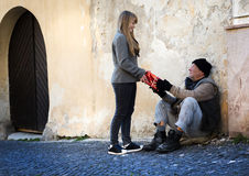 Christmas gift for homeless man royalty free stock images