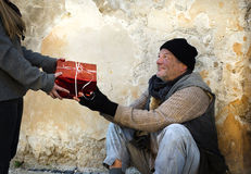 Christmas gift for homeless man Stock Photography