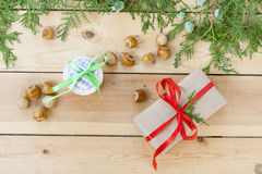Christmas gift, homemade cookies with chocolate and green arborvitae branch on a wooden table Stock Image