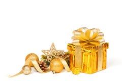 Christmas Gift isolated on white. Christmas Gold Gift isolated on white. Studio shot stock photos