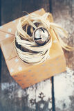 Christmas Gift with Jingle Hand Bell and Natural Royalty Free Stock Photography