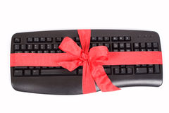 Christmas gift - keyboard. Christmas gift - computer keyboard with red ribbon royalty free stock image