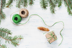 Christmas gift, knitted blanket, pine cones, fir branches Stock Photos