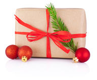 Christmas gift in kraft paper tied a red braid Isolated Stock Photography
