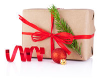 Christmas gift in kraft paper tied red braid Isolated on white Royalty Free Stock Photo