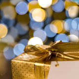 Christmas gift with label sparkling lights background Royalty Free Stock Photography