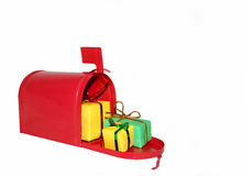 Christmas gift mailbox. Red mailbox full of Christmas gifts stock photo