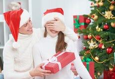Christmas gift. man gives a woman gift present box Stock Image