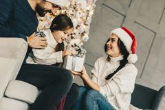 Christmas gift, Mom give festive box container her daughter, Holidays Family celebration stock images