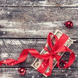 A Christmas gift, money, Xmas items, on a wooden background. Top view. Effect snowflakes.  stock images
