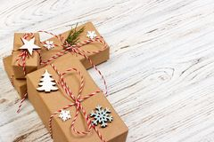 Christmas gift or New Year background: fir tree branch, star and snowflake decoration on a white wooden background Stock Photography