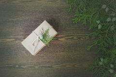 Christmas Gift, nuts, cones and green arborvitae branch on a wooden table. Selective focus Stock Image