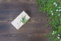 Christmas Gift, nuts, cones and green arborvitae branch on a wooden table. Selective focus Royalty Free Stock Photo