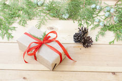 Christmas Gift, nuts, cones and green arborvitae branch on a wooden table. Selective focus Royalty Free Stock Photos