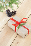 Christmas Gift, nuts, cones and green arborvitae branch on a wooden table. Selective focus Stock Photos