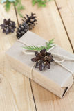 Christmas Gift, nuts, cones and green arborvitae branch on a wooden table Stock Photo