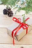 Christmas Gift, nuts, cones and green arborvitae branch on a wooden table. Selective focus Stock Photography