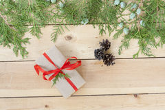 Christmas Gift, nuts, cones and green arborvitae branch on a wooden table. Selective focus Royalty Free Stock Photography