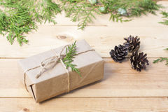 Christmas Gift, nuts, cones and green arborvitae branch on a wooden table. Selective focus Stock Images