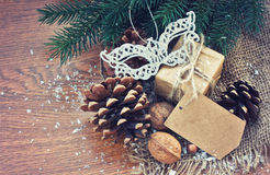 Christmas gift with old paper tag, decorative mask Royalty Free Stock Images