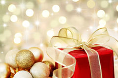 Free Christmas Gift On Defocused Lights Background Royalty Free Stock Photography - 11307607