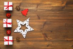 Christmas gift and ornament. On old wooden table stock photography