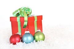 Christmas gift with ornaments. A christmas gift with snow and ornaments Stock Photos